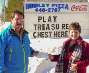 Bay Treasure Chest's Harry Ward presents a cheque for $13,730 to winner Maureen Cyr