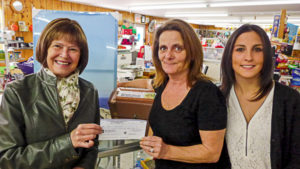 Anne Martell (L), Bay Treasure Chest Volunteer presents a cheque to Chris Morash and her daughter Beth Morash (L)
