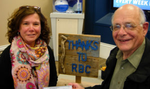 Darlene Bennett (L) receives her winner's cheque from Fred Dolbel (R), Bay Treasure Chest volunteer