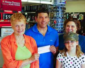 Doug Slaunwhite receives his cheque from Beth McGee, a Bay Treasure Chest volunteer
