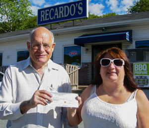 Susan Keast (R) receives her winner's cheque from Fred Dolbel, Bay Treasure Chest volunteer