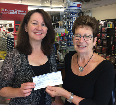 Susan Picton (R) of the Bay Treasure Chest presents a cheque for $4,109 to Jean Hunt of Haliburton Hills at Redmonds Hardware.