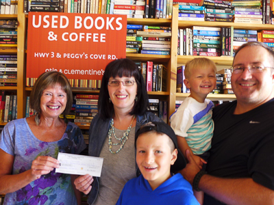 Bay Treasure Chest Winner Anne Martell (L) from Bay Treasure Chest, presents a cheque to Lori Saunders who is joined on this happy occasion by her youngest son Rory, husband Chris and oldest son Liam (front and centre)