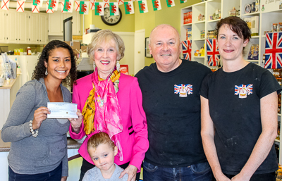 Pictured presenting the cheque to Barb is Chanice Johnson, a Bay Treasure Chest Volunteer from the Toy Library and her 4-year old daughter Nile, Denis Dineen, Delish owner, and Claire Francis, Delish manager.