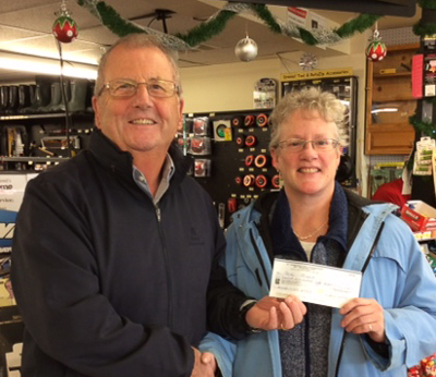 Norman Picton (L), BTC volunteer, presents a cheque for $5,750 to Norma Minard.