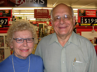 Dec. 9th winner Patricia Bonang (L) and Fred Dolbel, Bay Treasure Chest Volunteer