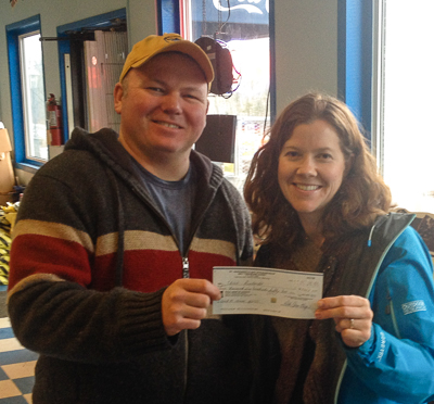 Kellie Allen (R), Bay Treasure Chest Volunteer presenting cheque to Chris (L) at Hubley Pizza.