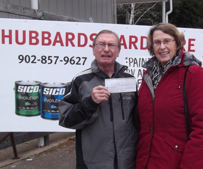 David (L) receiving his cheque from Ruth Ann Moger, Bay Treasure Chest Volunteer.