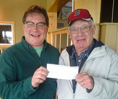 Jim (R) receiving his cheque from Harry Ward (L), Bay Treasure Chest Volunteer