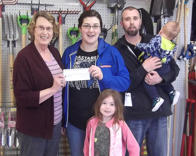 Ruth Ann Moger (L), Bay Treasure Chest Volunteer presents cheque to Lyndsey and Family