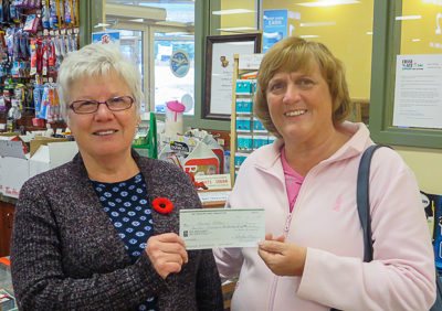 Brenda Miller (right) receiving her $14,421 cheque from the October 26 2016 Draw from Bay Treasure Chest volunteer Brenda Gray.