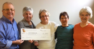 Norman Picton (L), Chair of Bay Treasure Chest Association presenting a $500 honorarium cheque to the SMB Food Bank represented by (L to R) Louise Sullivan, Gwen Christie, Roma Kennedy,and Donna Vienneau