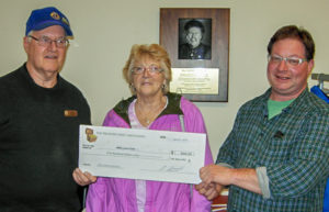 Representing the SMB Lions Club: Reg Sollows (L) and Margot Fraser accept the honorarium cheque from BTC volunteer Harry Ward (R). Lions members Lydia Boutilier and Richard Fetham also assisted.