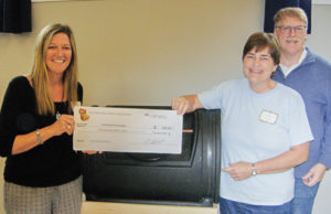 Representing the Three Brooks Homeowners Association: Beth Rogers (L), Heidi Clough (C) and Tim McClare (R) accept their Treasure Chest honorarium cheque. Three Brooks volunteer Laura Johnston also assisted.
