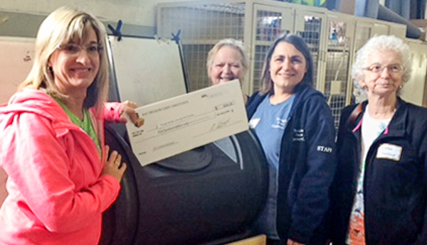 Representing the Through the Years Community Centre Daycare group (L to R): Mary Ellen Shatford, Dawn Coffin, Carol Coolen, and Gladys Shatford accept their Treasure Chest honorarium cheque.